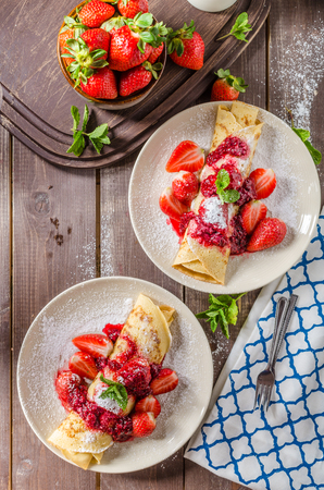 styled: Pancakes with jam and strawberries, french classic crepes styled pancakes