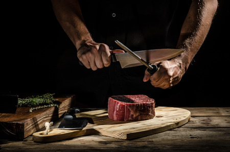 prime adult: Butcher with a beef steak