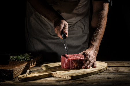 Butcher with a beef steak