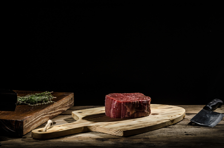 prime adult: Raw beef steak