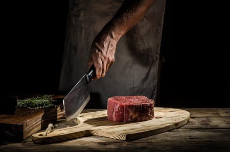 Butcher with beef steak