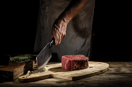 Butcher with beef steak