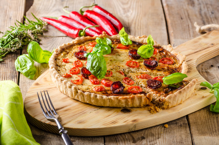 chili peppers: Homemade quiche with chili peppers, cheese and chorizo Stock Photo