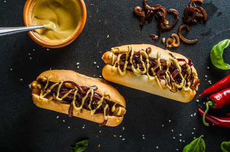 hotdogs: All beef hotdogs, delicious full of meat with caramelized red onion, french mustard and chilli dogs Stock Photo
