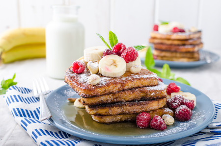 maple syrup: French toast with banana, forest fruit and maple syrup and milk