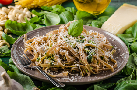 simple meal: Pasta with pesto, ingredience around meal, simple and delicious italian meal