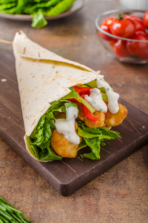 breaded: Tortilla with breaded chicken, lettuce and garlic dip with herbs