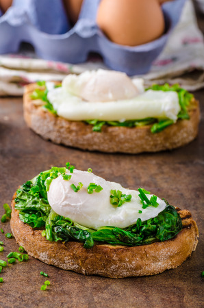benedict: Roasted rustic bread with poached egg and garlic spinach