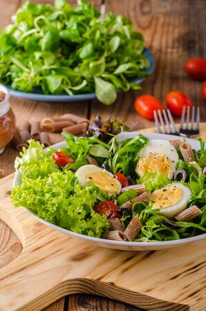 Fresh salad with boiled egg and pasta Stock Photo