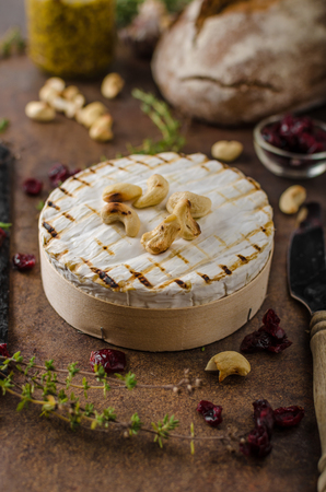 Grilled camembert cheese, delicious and fast food with creamy cheese Stock Photo