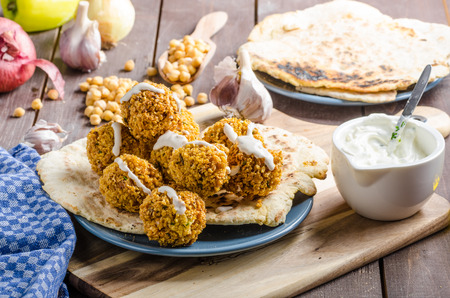 Falafel fried on naan bread, with garlic sauce