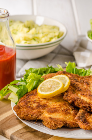 Delicious schnitzel with salad, mashed potatoes, homemade ketchup