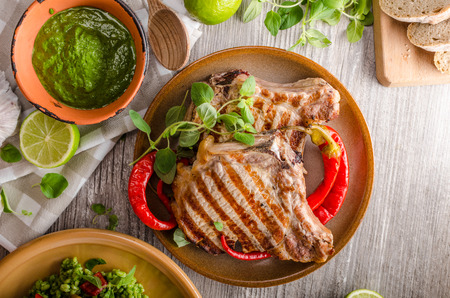 styled: Grilled Pork Chops and risotto with portobello, rustic styled photo Stock Photo