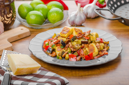 Home baked gnocchi with bacon and Mediterranean vegetables
