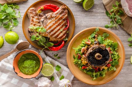 portobello: Grilled Pork Chops and risotto with portobello, rustic styled photo Stock Photo