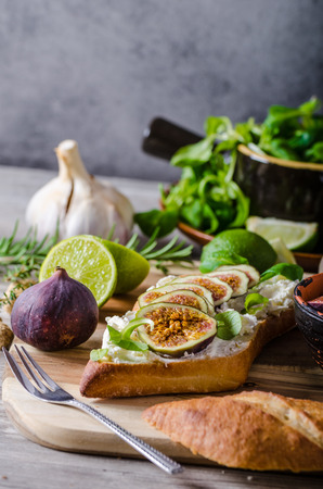 sandwitch: Fresh baguette with cheese and fresh figs, simple sandwitch