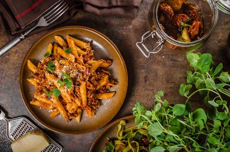 Pasta arrabiata delicious, spicy and simple delicious pasta with meat and parmesan cheese Archivio Fotografico