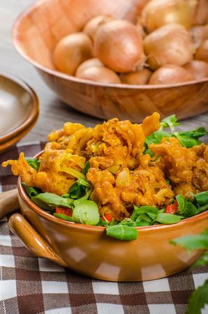 Crispy onion bhajis, delicisous brazilian street food on salad Stock Photo