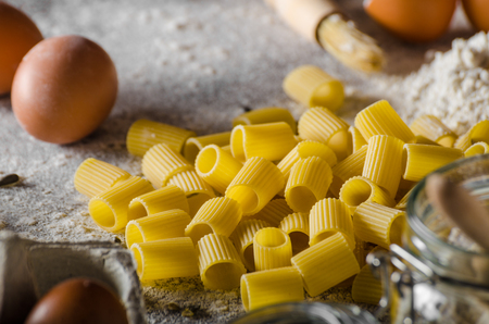 semolina pasta: Homemade pasta bio, styled, ready for your advertisment, text free, rustic styled photo