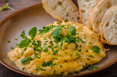 Scrambled eggs with herbs and toast