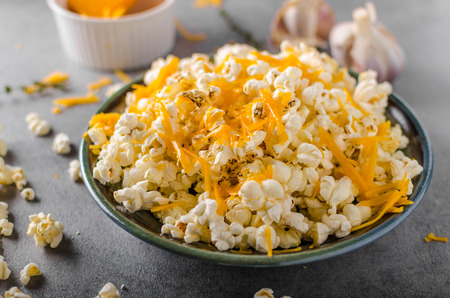 Homemade cheese popcorn with garlic, herbs and cheddar cheese Stock Photo