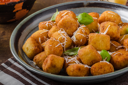 Golden fried mini croquette with parmesan cheese, delicious with tomato dip
