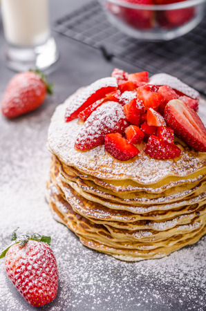 American pancakes with strawberries, topped with sugar Stock Photo