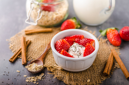 Fresh granola with organic yogurt, berries and milk Stock Photo