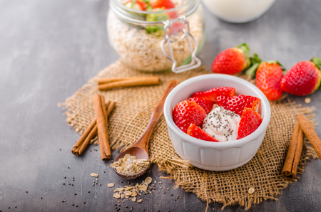 Fresh granola with organic yogurt, berries and milk Stock Photo