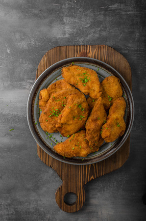 Breaded original schnitzel, with lemons, chive and pickless