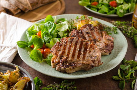 Grilled pork chops with with salad and potato salad