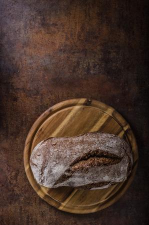 cutting: Wholegrain rustic bread, delish homemade bread product photo