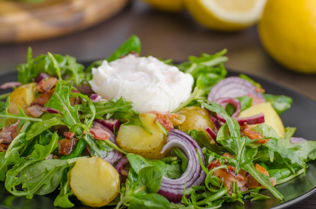 plate: Potato lettuce salad with poached egg and onion