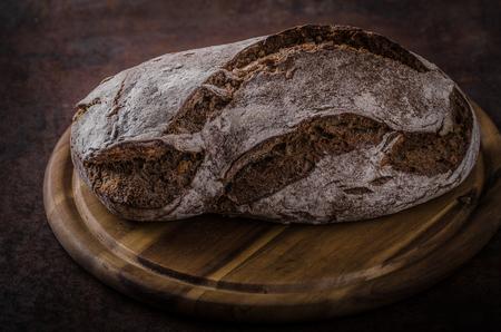 Wholegrain rustic bread, delish homemade bread product photo