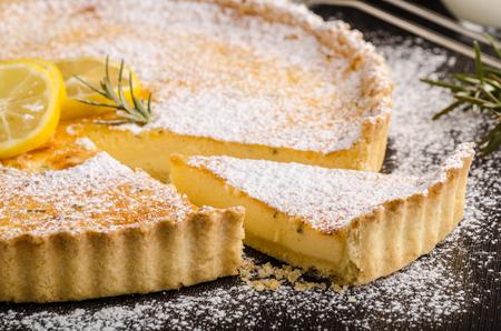 Delish leamon tart, delicious dessert, place for text Фото со стока
