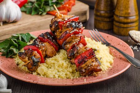 Chicken skewers say sauce, healthy food couscous Stock Photo