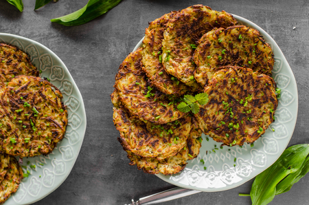 Potato pancakes fried with garlic and herbs