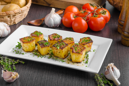 Potato fondant with garlic and herbs, delish simple meal Stock Photo