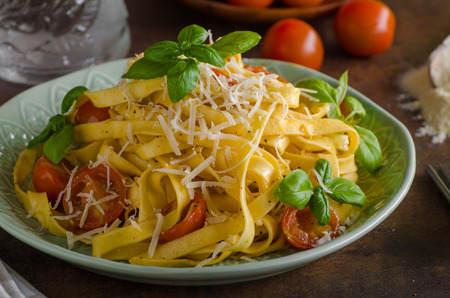Pasta semolina with tomatoes and parmesan cheese, italian meal