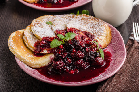 Crepes pancakes with berries reduction, delis breakfast