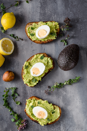 Bio avocado on bread with boiled egg, delish food