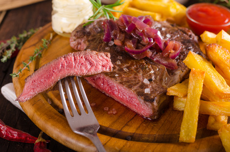 Beef steak with homemade french fries, beer and tartar sauce, food photography Stock Photo