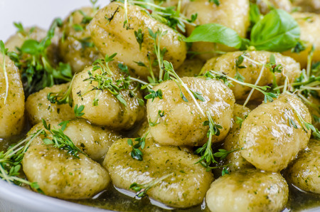 Pesto gnocchi, garlic and fresh herbs olive oil, delish homemade, food photography Stock Photo