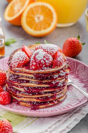 Pancakes strawberry, sugar and jam Stock Photo