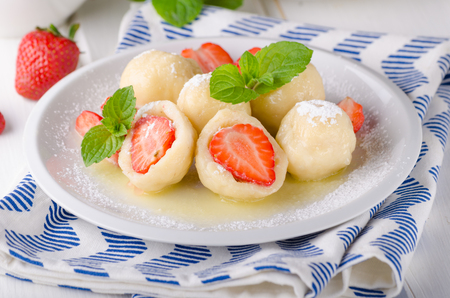 Stuffed strawberry dumplings, delish dessert with herbs, food photography