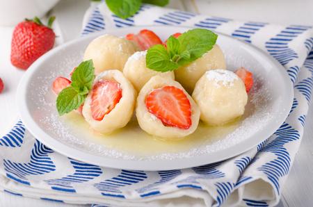 Stuffed strawberry dumplings, delish dessert with herbs, food photography Banco de Imagens - 100948914
