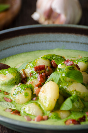 Gnocchi with bacon and basil spinach sauce, delish food photography, food advertisment Stock Photo