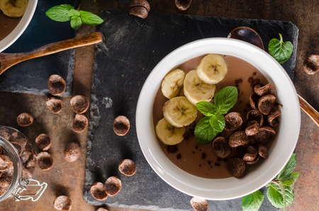 Chocolate pudding, banana and herbs in, food photography, product photo Stock Photo