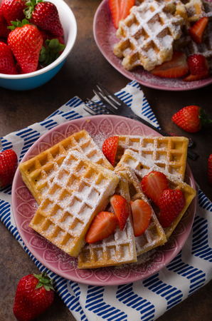 Waffles with berries, strawberries, chocolate on top and mint Standard-Bild - 102887109