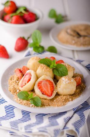 Stuffed strawberry dumplings, delish dessert with herbs Banco de Imagens